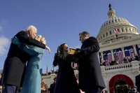 U.S. President Joe Biden and first lady Jill Biden kiss as his son Hunter Biden and daughter Ashley Biden look on after being sworn-in during the 59th Presidential Inauguration at the U.S. Capitol in Washington, on Jan. 20, 2021. (AP Photo/Andrew Harnik, Pool)