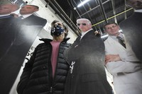 Stephen Taren, who owns Wet Paint Printing + Design in Wilkes-Barre, puts his arm around a life-sized cutout of Joe Biden with Dr. Anthony Fauci, right, and former President Obama, on Jan. 19, 2021 in Wilkes-Barre, Pennsylvania. (Mark Moran/The Citizens' Voice via AP)