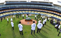 In this photo provided by the Los Angeles Dodgers, the casket of Hall of Fame manager Tommy Lasorda is seen on the mound during a ceremony at Dodger Stadium, on Jan. 19, 2021, in Los Angeles. (Jon SooHoo/Los Angeles Dodgers via AP)