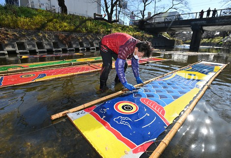 Japan Photo Journal: Carp streamers cleansed in cold river water in annual ritual