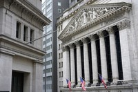 This Nov. 23, 2020 file photo shows the New York Stock Exchange, right, in New York. (AP Photo/Seth Wenig)