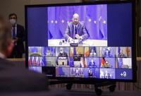 European Council President Charles Michel, top, and European leaders are shown on screen during a EU summit video conference at the European Council headquarters in Brussels, Jan. 21, 2021. (Oliver Hoslet, Pool Photo via AP)