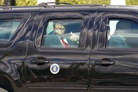 President Donald Trump gestures to supporters en route to his Mar-a-Lago Florida Resort on Jan. 20, 2021, in West Palm Beach, Fla. (AP Photo/Lynne Sladky)