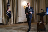 In this Jan. 20, 2021, file photo, President Joe Biden leaves after attending a virtual swearing in ceremony of political appointees from the State Dining Room of the White House in Washington. (AP Photo/Evan Vucci)
