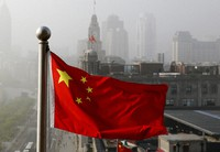In this April 14, 2016 file photo, a Chinese national flag flutters against the office buildings in Shanghai, China. (AP Photo/Andy Wong)