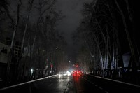 Cars drive on an unlit street during a blackout in Tehran, Iran, on Jan 20, 2021. (AP Photo/Ebrahim Noroozi)