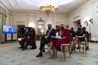 Doug Emhoff, left, Vice President Kamala Harris, President Joe Biden, and first lady Jill Biden bow their heads in prayer during a virtual Presidential Inaugural Prayer Service, in the State Dining Room of the White House on Jan. 21, 2021, in Washington. (AP Photo/Alex Brandon)
