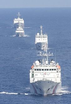 This Sept. 10, 2013 file photo taken from a Mainichi Shimbun airplane shows China Coast Guard vessels near the Japanese-controlled Senkaku Islands in the East China Sea. (Mainichi)