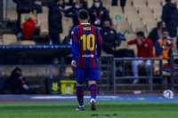 Barcelona's Lionel Messi walks out of the pitch after being shown a red card during the Spanish Supercopa final soccer match against FC Barcelona at La Cartuja stadium in Seville, Spain, on Jan. 17, 2021. (AP Photo/Miguel Morenatti)
