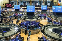 In this photo provided by the New York Stock Exchange, traders work on the floor during the United Wholesale Mortgage IPO, on Jan. 22, 2021. (Courtney Crow/New York Stock Exchange via AP)