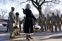 First lady Jill Biden surprises National Guard members outside the Capitol with chocolate chip cookies, on Jan. 22, 2021, in Washington. (AP Photo/Jacquelyn Martin, Pool)
