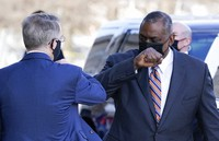 Defense Secretary Lloyd Austin, right, greets Deputy Secretary of Defense David Norquist as he arrives at the Pentagon, on Jan. 22, 2021, in Washington. (AP Photo/Alex Brandon)