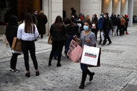 Youths stand in a queue as they wait to enter a clothes shop on Ermou Street, Athens' main shopping area, on Jan. 22, 2021. (AP Photo/Thanassis Stavrakis)