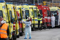 More than a dozen ambulances queue waiting to hand over their COVID-19 patients to medics at the Santa Maria hospital in Lisbon, on Jan. 22, 2021. (AP Photo/Armando Franca)
