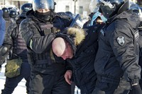 Police detain a man during a protest against the jailing of opposition leader Alexei Navalny in Khabarovsk, 6,100 kilometers (3,800 miles) east of Moscow, Russia, on Jan. 23, 2021.  (AP Photo/Igor Volkov)