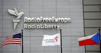 In this Jan. 15, 2010, file photo, the headquarters of Radio Free Europe/Radio Liberty is seen with U.S., RFE/RL and the Czech Republic flags in the foreground in Prague. (Michal Kamaryt/CTK via AP)