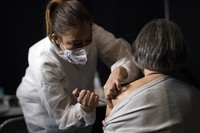 A woman recieves a dose of the Moderna COVID-19 vaccine at a vaccination center in Le Cannet, southern France, on Jan. 21, 2021. (AP Photo/Daniel Cole)