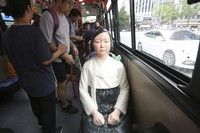 In this Aug. 14, 2017 file photo, a comfort woman statue is placed on a chair of a bus to mark the 5th International Memorial Day for Comfort Women, in Seoul, South Korea. (AP Photo/Ahn Young-Joon)