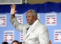 Hall of Famer Hank Aaron waves to the crowd during Baseball Hall of Fame induction ceremonies in Cooperstown, N.Y., in this on July 28, 2013, file photo.  (AP Photo/Mike Groll)