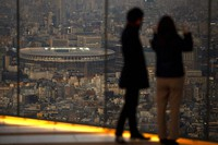 Japan National Stadium, where opening ceremony and many other events are planned for postponed Tokyo 2020 Olympics, is seen from a rooftop observation deck on Jan. 21, 2021, in Tokyo.  (AP Photo/Kiichiro Sato)