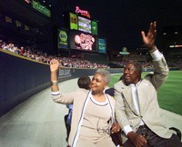 Major League Baseball's all-time career home run record holder Hank Aaron and his wife Billye take a lap in a golf cart around Turner Field in Atlanta, on April, 8, 1999, after a ceremony to mark the 25th anniversary of his breaking Babe Ruth's record of 714 home runs on April 8, 1974. (AP Photo/John Bazemore)