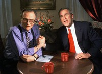 In this Dec. 16, 1999 file photo, Republican presidential candidate Texas Gov. George W. Bush jokes with CNN's Larry King after finishing the