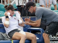 In this March 21, 2019 file photo, Bianca Andreescu, of Canada, left, talks with her coach Sylvain Bruneau during her match against Irina Camelia Begu, of Romania, at the Miami Open tennis tournament in Miami Gardens, Fla. (AP Photo/Lynne Sladky, File)