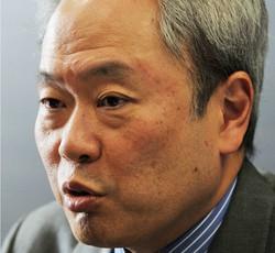 多くの企業再生に携わってきた冨山和彦さん=東京都千代田区で2014年5月7日、内藤絵美撮影