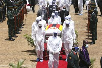 Pallbearers carry the coffin of government minister Dr Ellen Gwaradzimba who died of COVID-19, in Harare, on Jan. 21, 2021. (AP Photo/Tsvangirayi Mukwazhi)