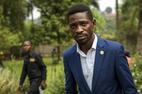 In this Jan. 15, 2021 photo, Uganda's leading opposition challenger Bobi Wine walks back to his residence after giving a press conference, outside Kampala in Uganda. (AP Photo/Jerome Delay)