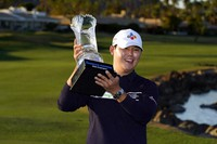 Si Woo Kim holds the winner's trophy at the end of the American Express golf tournament on the Pete Dye Stadium Course at PGA West, on Jan. 24, 2021, in La Quinta, Calif. (AP Photo/Marcio Jose Sanchez)