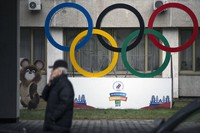 In this Nov. 28, 2019 file photo, Olympic rings and a model of Misha the Bear Cub, the mascot of the Moscow 1980 Olympic Games, left, are seen in the yard of Russian Olympic Committee building in Moscow, Russia. (AP Photo/Pavel Golovkin)