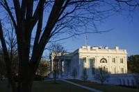 The setting sun falls on the White House in Washington, on Jan. 23, 2021. (AP Photo/Patrick Semansky)
