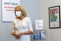 First lady Jill Biden smiles as she tours Whitman-Walker Health, on Jan. 22, 2021, in Washington. (AP Photo/Jacquelyn Martin, Pool)
