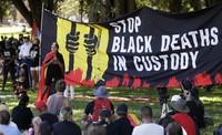 A speaker addresses a crowd during an Aboriginal-lead Invasion Day rally on Australia Day in Sydney, Australia, on Jan. 26, 2021. (AP Photo/Rick Rycroft)