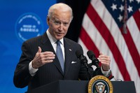 In this Jan. 25, 2021 photo, U.S. President Joe Biden answers questions from reporters in the South Court Auditorium on the White House complex, in Washington. (AP Photo/Evan Vucci)