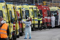 In this Jan. 22, 2021 photo, more than a dozen ambulances queue waiting to hand over their COVID-19 patients to medics at the Santa Maria hospital in Lisbon, Portugal. (AP Photo/Armando Franca)