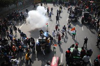 Police use tear gas to disperse farmers who marched to the capital during India's Republic Day celebrations in New Delhi, India, on Jan.26, 2021. (AP Photo/Altaf Qadri)