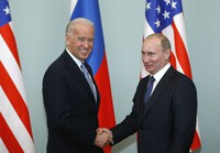 In this March 10, 2011 file photo, then-U.S. Vice President Joe Biden, left, shakes hands with Russian Prime Minister Vladimir Putin in Moscow, Russia. (AP Photo/Alexander Zemlianichenko)