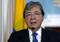 In this Oct. 9, 2019 file photo, Colombian Foreign Minister Carlos Holmes Trujillo speaks to reporters after a bilateral meeting at the Department of State in Washington. (AP Photo/Jose Luis Magana)