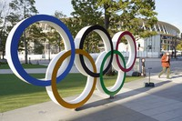The Olympic rings and National Stadium are pictured in Tokyo on Jan. 22, 2021. (Kyodo)