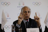 In this April 6, 2019 file photo, President of the Italian National Olympic Committee Giovanni Malago gestures as he talks during a winter Olympics Milan Cortina bid IOC Evaluation Commission final news conference, in Milan, Italy. (AP Photo/Luca Bruno)