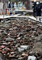 Bricks that collapsed in the bombing are seen left lying on the ground inside the Atomic Bomb Dome in Hiroshima's Naka Ward on Jan. 27, 2021. (Mainichi/Naohiro Yamada)