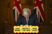 Britain's Prime Minister Boris Johnson reacts while leading a virtual press conference on the Covid-19 pandemic, inside 10 Downing Street in central London on Jan. 26, 2021. (Justin Tallis / Pool via AP)