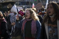 Students chant slogans during a demonstration in Marseille, southern France, on Jan. 26, 2021. (AP Photo/Daniel Cole)