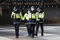 South Korean police officers wearing face masks as a precaution against the coronavirus walk in Seoul, South Korea, on Jan. 25, 2021. (AP Photo/Lee Jin-man)