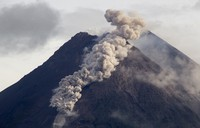 Hot cloud of volcanic materials run down the slope of Mount Merapi during an eruption in Sleman, Indonesia, on Jan. 27, 2021. (AP Photo/Slamet Riyadi)