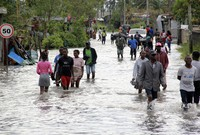 People make their way through floodwaters in Beira, Mozambique, on Jan. 23, 2021. (AP Photo)