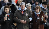 In this Jan. 27, 2019 file photo, survivors of the Nazi death camp Auschwitz arrive for a commemoration ceremony on International Holocaust Remembrance Day at the International Monument to the Victims of Fascism inside Auschwitz-Birkenau in Oswiecim, Poland. (AP Photo/Czarek Sokolowski)