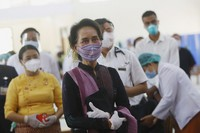 Myanmar leader Aung San Suu Kyi inspects and watches the vaccination processes to health workers at a hospital on Jan. 27, 2021, in Naypyitaw, Myanmar. (AP Photo/Aung Shine Oo)